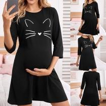 Niedliches Kleid mit Katzenmotiv 3/4 Ärmeln und Rundhalsausschnitt