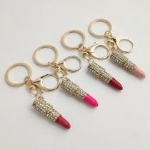 Moderner Schlüsselanhänger mit Strass und Lippenstiftanhänger