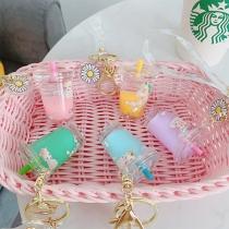 Kreatives Schlüsselbund mit Art Gänseblümchen Einhorn Milch Tee und Becher als Anhänger