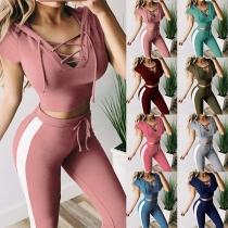 Sexy Sportanzug bestehend aus Crop Top mit Geschnürtem V-Ausschnitt und Hose