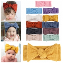 Nettes Elastisches Stirnbandset für Babys mit Volltonfarbe und Schleife 2 Stück / Set